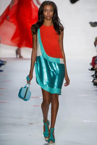 Diane von Fürstenberg's metallic acqua and orange outfit here