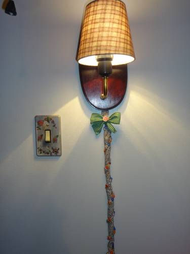 I love bows! I covered the lamp's wire with fabric and beads. The lamp shade was made to measure with my fabric choice