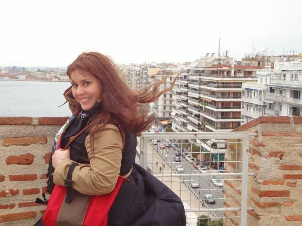 "On the top of one of the city's ""postcards"", the White Tower. Windy! I love this photo!"
