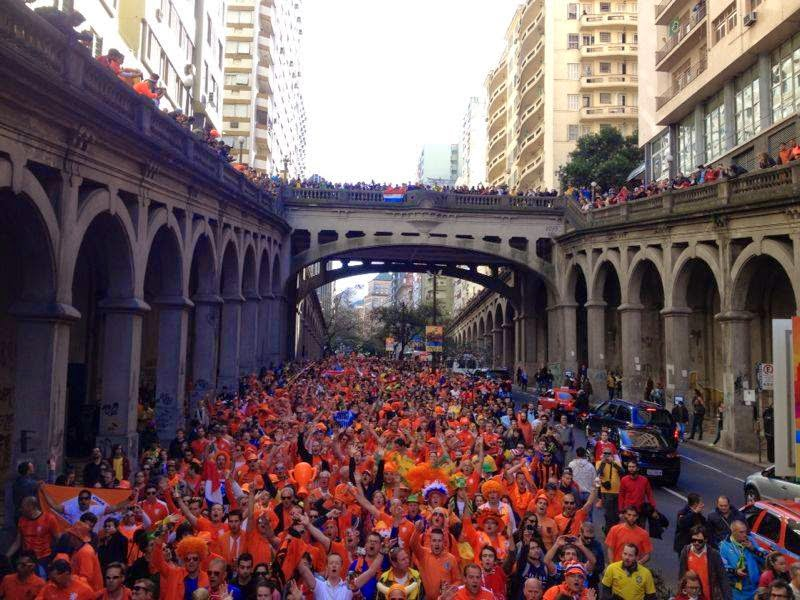 Dutch supporters on a street of one of the World Cup cities, walking to the stadium