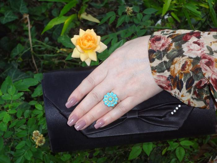 A black clutch from Montevideo and a blue ring - plus a rose in my garden!