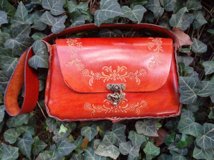 Leather bag - it's not red, it's the light!