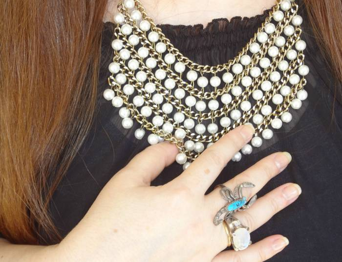 Pearl necklace, Quincy. Rings: moon stone, don't remember; scorpion, from Germany
